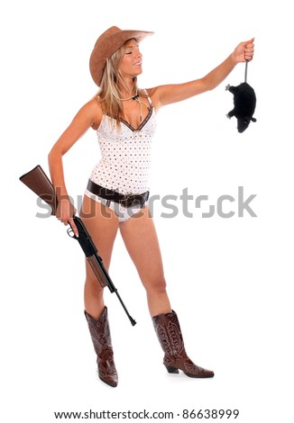 Funny picture of the pretty woman in a cowboy costume with rifle holding big rat. - stock photo