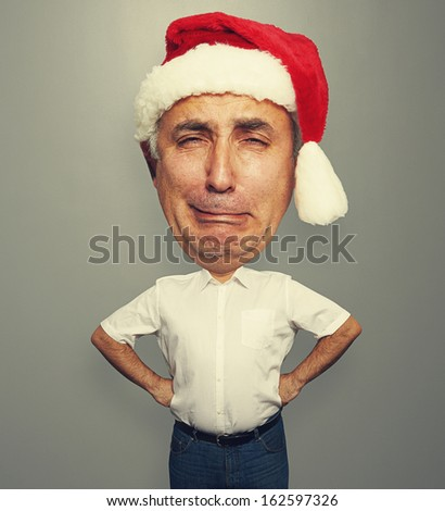 funny picture of unhappy senior man in red santa hat