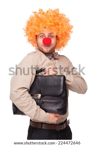 Funny picture of young businessman wearing clown wig and nose and holding briefcase, isolated on white