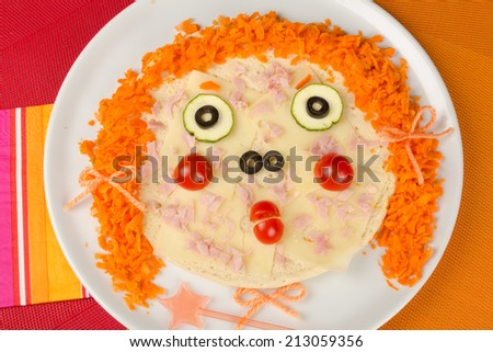 Funny pizza decorated as a face,  a kid meal