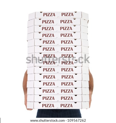 Funny pizza delivery boy with many pizza boxes isolated on white background - stock photo