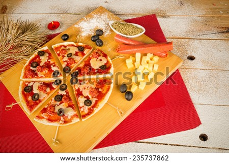 Funny pizza with triangles arranged as a Christmas tree, kid food - stock photo