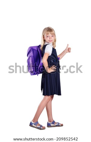 Funny portrait of a cheerful schoolgirl on white background. School and Education - stock photo