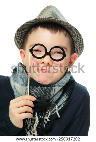 Funny portrait of boy wearing a hat with party glasses on white background - stock photo