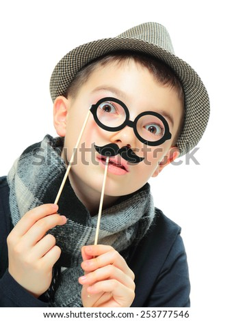 Funny portrait of boy wearing a hat with party mustache and glasses on white background - stock photo