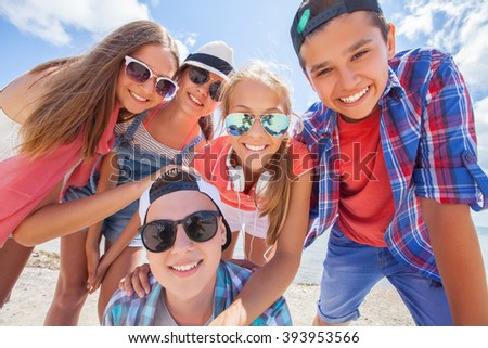 funny portrait of group of teenagers spending time together - stock photo