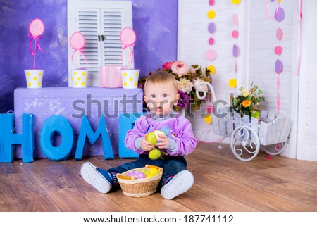 Funny portrait of happy boy playing with Easter eggs fun game