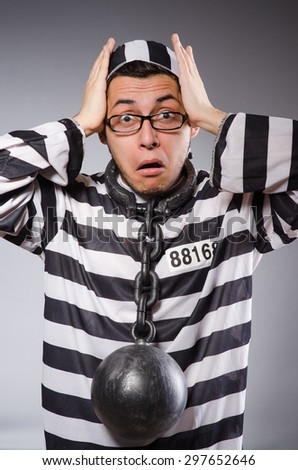 Funny prisoner in chains isolated on gray - stock photo