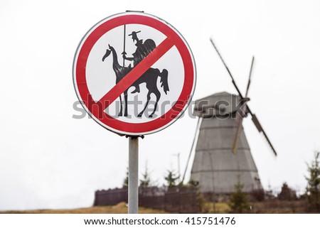 Funny prohibitory road sign, Don Quixote ban - stock photo