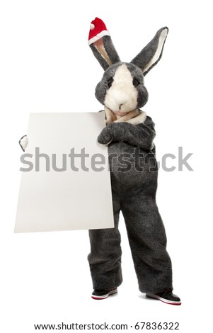 Funny rabbit with blank sheet of paper and place for your text on black background - stock photo