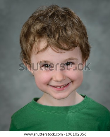 Funny red hair boy in the studio - stock photo
