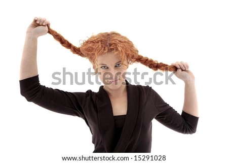 Funny redhead playing with her curly braids