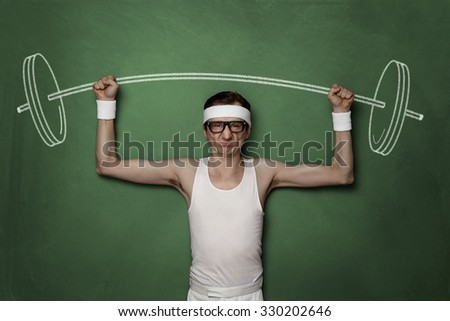 Funny retro sport nerd lifting weights drawn on a chalkboard - stock photo