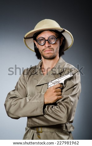 Funny safari hunter against background - stock photo