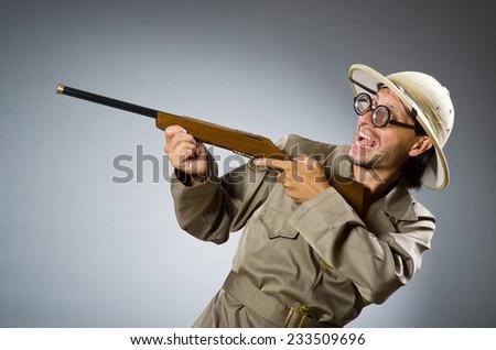 Funny safari hunter with rifle - stock photo