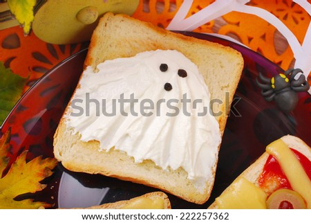 funny sandwich with cheese ghost for halloween party - stock photo