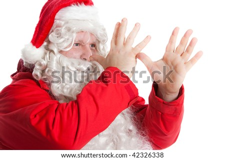 funny Santa Claus showing long nose with two hands