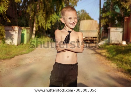Funny Schoolboy in Tie Outdoor in Summer Day. Back to School. First time to School. Childhood and Freedom - stock photo