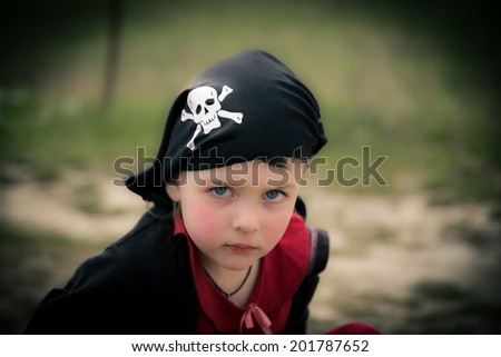 Funny serious  girl in pirate bandana - stock photo