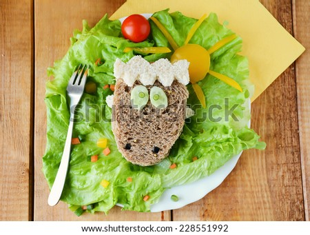 Funny sheep shaped sandwich for kids, healthy breakfast - stock photo
