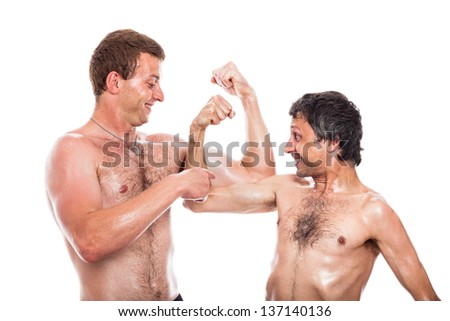 Funny shirtless men comparing muscles, isolated on white background - stock photo