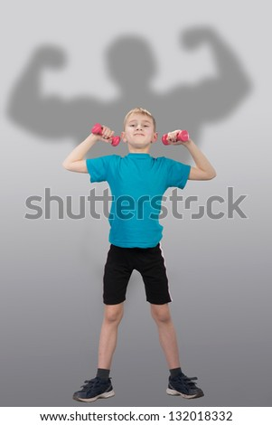 Funny slim boy with bodybuilder's silhouette behind him - stock photo
