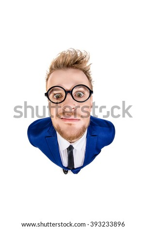 Funny smart guy in a suit and spectacles staring into the camera. Isolated over white. - stock photo