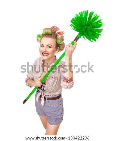 Funny smile housewife / girl with broom, isolated on white. Above shot of a domestic woman