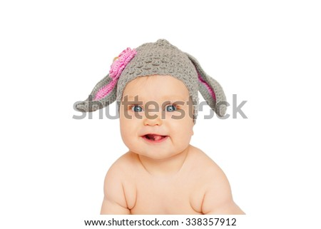 Funny smiling baby like easter bunny or lamb. Isolated on white background
