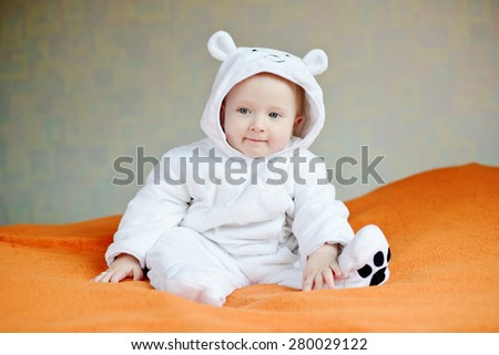 funny smiling baby wearing costume of polar bear - stock photo