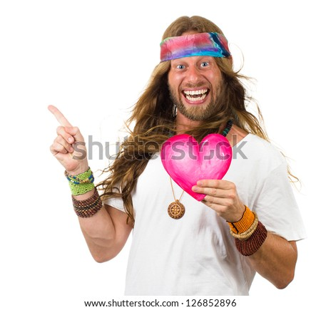 Funny, smiling hippie man holding a love heart and pointing up at copy-space. Isolated on white. - stock photo