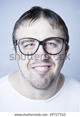 Funny smiling man in glasses - stock photo