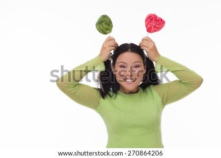 Funny smiling sexy asian woman with candy - stock photo