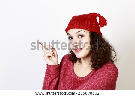 Funny smiling woman with curly hair and red hat, isolated - stock photo