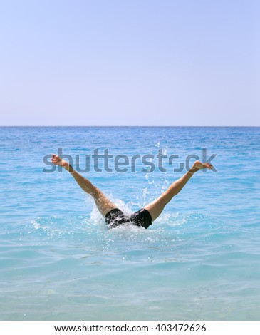Funny summer holiday concept - legs of man swimming - stock photo