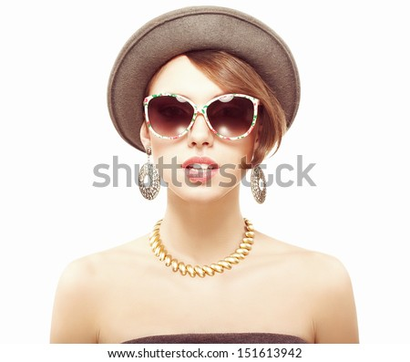 Funny summer portrait of a beautiful girl in hat, looking at camera
