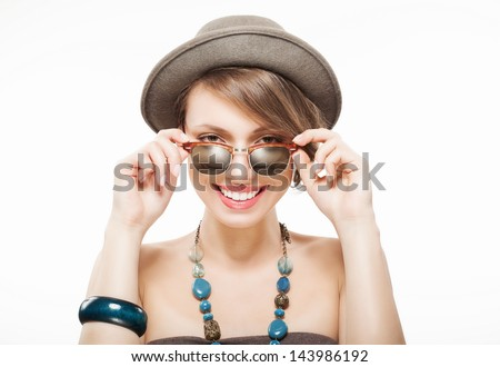 Funny summer portrait of girl in hat, holding sunglasses with hands - stock photo