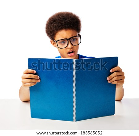 Funny, surprised African American teenager, school boy with glasses reading book with shock - stock photo