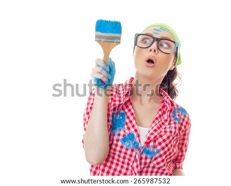 Funny surprised woman painter holding paint brush, girl ready for renovating or painting, isolated on white. House painter.
