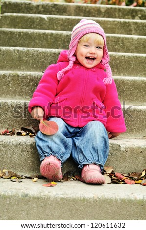 funny sweet toddler on the stairs - stock photo