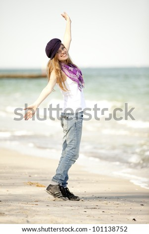 Funny teen girl at the beach. - stock photo