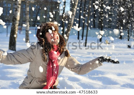 funny  teenager  girl playing in deep  snow - stock photo