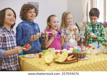 Funny time during the painting Easter eggs  - stock photo