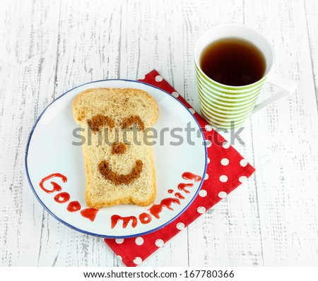 Funny toast, on color wooden background - stock photo