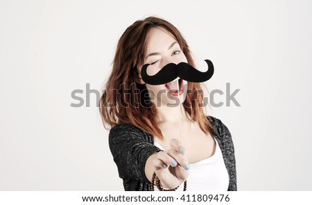 funny trendy fashion girl with paper mustache playing with emotion - stock photo