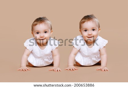 Funny twins baby - stock photo