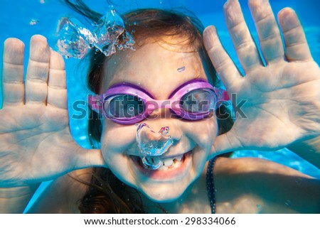 Funny underwater portrait of  cheerful girl - stock photo
