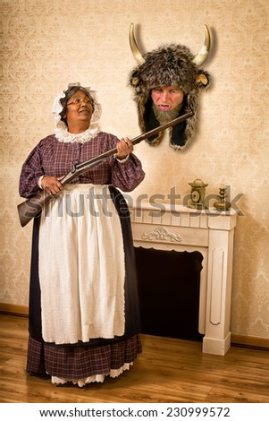 Funny Victorian wife holding a gun in front of her dead husband as a hunting trophy - stock photo
