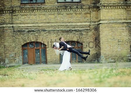 Funny wedding couple - stock photo