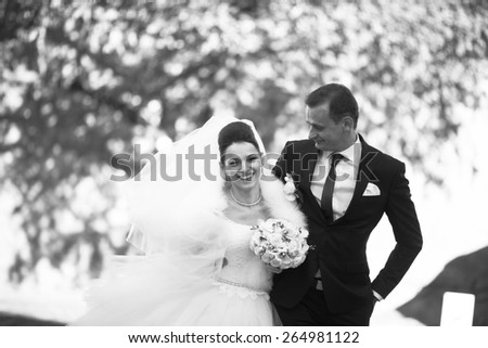 funny wedding couple walk in the city lvov - stock photo